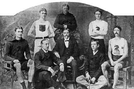Several members of America's first Olympic team in 1896. Standing: T.E. Burke, Thomas P. Curtis, '94, Ellery H. Clark. Seated: W.W. Hoyt, Sumner Paine, Trainer John Graham, John B. Paine, Arthur Blake.