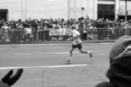 "Sophomore Dan Feldman placed 62nd out of nearly 18,000 runners in the Boston Marathon. Mr. Feldman said that when this photo was taken near Lord & Taylor on Boylston Street, ""all I could think about was, 'get me to the finish line.'"""