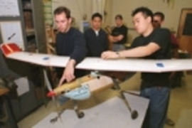 Showing off some of the Air Camel's finer features are the aircraft's designer/builders, all students in aeronautics and astronautics. Left to right: Larry Baskett, Allen Chen, Larry Pilkington, Jacob Markish (partly hidden) and Bernard Ahyou. Not pictured are Carol Cheung, Dan Benhammou and Adam Diedrich.