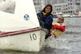 Madhulika Jain (left) and Alan Sun practice in their Flying Junior out on Boston Harbor.