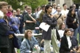 Attendees at Thursday's student-organized peace rally at MIT listen to a speaker.