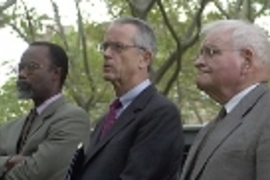 Chancellor Phillip Clay (left), President Charles Vest (center) and President Emeritus Paul Gray listen to speakers and music at the MIT community gathering
