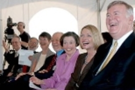 Laughing at the groundbreaking for the McGovern Institute are, seated from left: President Charles M. Vest; Dean of the School of Science Robert J. Silbey; Mrs. Ann Sharp; Phillip A. Sharp, professor of biology and director of the McGovern Institute for Brain Research; Mrs. Rebecca Vest; Lore Harp McGovern, and Patrick McGovern.