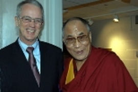 Vest shakes hands with the Dalai Lama, who visited MIT in September.