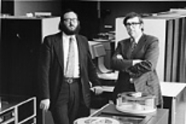 Joel Moses and Michael Dertouzos (then associate director and director, respectively, of the Lab for Computer Science) in the laboratory during the mid-1970s.
