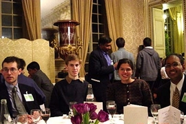 From left, MIT juniors Benjamin Schwartz and Sean Markan, alumna Natalia Toro, and sophomore Chintan Hossain enjoy themselves during a banquet at the Physics for Tomorrow conference held in Paris.