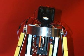 'Toddler,' a walking robot developed at MIT, takes a step.