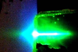 A sensor film made of a novel semiconducting organic polymer undergoes a lasing process when exposed to ultraviolet light. When TNT is present, it binds to the polymer and quenches the beam.