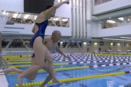 Barrie and Al Zesiger leap into one of two pools at the MIT fitness center that bears their names. The Al and Barrie Zesiger Sports and Fitness Center won a recent popular vote for 'Best Swimming Pool' in the Boston area.