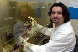Andrea Ventura, an MIT postdoctoral associate, works in the lab at the Center for Cancer Research. He and his colleagues have shown that by reactivating a certain gene, cancerous tumors in mice can be drastically reduced in size.
