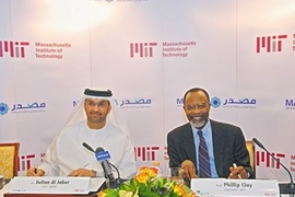 Abu Dhabi Future Energy Company CEO Sultan Al Jaber, left, and MIT Chancellor Phillip Clay prepare to sign the cooperative agreement.