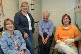 From left to right, Professors Linda Griffith and Leona Samson with Harvey Lodish of the Whitehead Institute, and graduate student Joe Shuga.