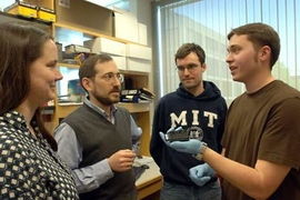 An MIT research team studying gene regulation in mouse and human liver cells has found that master regulatory proteins function differently in the two. From left, post-doc Robin Dowell, Professor Ernest Fraenkel,  graduate student Kenzie MacIsaac and research technician William Gordon discuss their research.