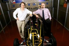 Jeroen Struben, left, and John D. Sterman, of the Sloan School, with an alternative vehicle in the MIT Museum.