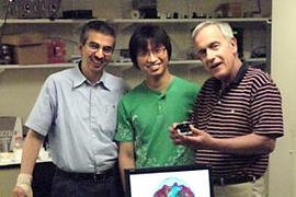 From left: Kamran Badizadegan, principal research scientist; Wonshik Choi, postdoc; and Michael Feld, physics professor and director of the MIT Spectroscopy Lab. The three have found a way to create 3D images of the inner workings of cells, as illustrated on monitor in front of them.