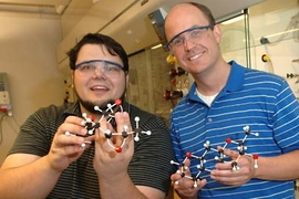 MIT Professor Tim Jamison, right, and co-author Ivan Vilotijevic, a grad student in chemistry, have discovered how the organisms behind red tide may produce the algal bloom's toxic effects. They hold models of molecules that, in water, transform into representative portions of the red tide toxins.