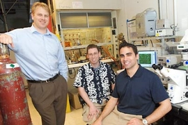 An MIT team has created polymer-DNA nanoparticles to deliver disease-fighting genes . From left are Daniel Anderson, a research associate at the MIT Center for Cancer Research, bioengineering graduate student Jordan Green and Greg Zugates, a Ph.D. candidate in chemical engineering.
