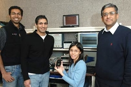 From left, electrical engineering graduate students Yogesh Ramadass, Naveen Verma and Joyce Kwong, along with Professor Anantha Chandrakasan. This team has developed a microchip that can be up to 10 times more energy-efficient than present technology.
