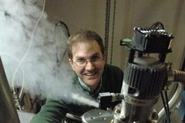 Assistant Professor of Physics Eric Hudson transfers liquid helium to cool the scanning tunneling microscope he is using in his research on high-temperature superconductivity.