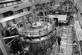 Senior research scientist Jay Kesner stands by the now-operational LDX fusion reactor, in which a series of experiments are being run.