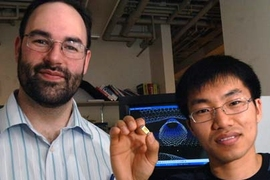 Michael Strano, associate professor of chemical engineering at MIT, and graduate student Chang Young Lee, right. Strano and his team have built a highly sensitive detector, here held by Lee, using carbon nanotubes that can sense very small quantities of neurotoxins.