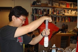 Royce Chew from Singapore works on a low-cost water testing device at last year's International Development Design Summit at MIT.