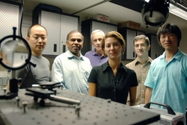 From left, graduate student YongKeun Park, School of Engineering Dean Subra Suresh, Professor Michael Feld, and postdocs Monica Diez-Silva, George Lykotrafitis and Wonshik Choi stand in the MIT Spectroscopy Laboratory. The group has used microscopy techniques to show in unprecedented detail how the malaria parasite attacks red blood cells.