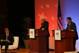 Representatives from the two presidential campaigns, R. James Woolsey, center, for Senator John McCain, and Jason Grumet for Senator Barack Obama, face off in a debate on energy policy held Monday night in Kresge Auditorium at MIT. NPR's Tom Ashbrook, left, moderated the debate.
