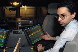 Shakeel Avadhany (Materials Science '09) monitors pressure, position, and generated power sensor data on the custom data acquisition system.