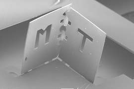A team of MIT researchers folded this polymer sheet into one corner of a cube. The edge of each face is about 800 microns.