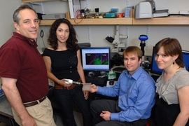 Professor Elazer Edelman, Natalie Artzi, Aaron Baker and Adriana Bon in the lab with a surgical adhesive they have developed.