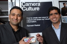 Ramesh Raskar, left, holds box with conventional barcode,