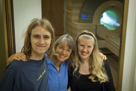 From left, MIT undergraduate Michael Behr, principal investigator Nancy Kanwisher and research scientist Evelina Fedorenko in front of the fMRI machine they use to measure real-time brain activity associated with language and other cognitive tasks.