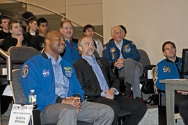 Video game developer and commercial spaceflight supporter Richard Garriott sits with astronauts (from left) Leland Melvin, John Grunsfeld, Jeff Hoffman and Greg Chamitoff.