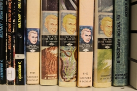 Between older and newer versions, the Society aims to maintain two copies of each volume in the library, such as these classic Tom Swift adventures.