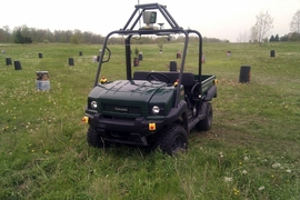 A utility vehicle equipped with a laser range finder drives through a field, avoiding obstacles without human intervention.