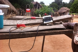 Charging solar lanterns in Ghana as part of an technology evaluation program.
