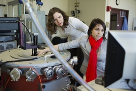 Laura Popa (left) and Dana Weinstein test their experimental chip using a cryogenic vacuum radio-frequency probe station.
