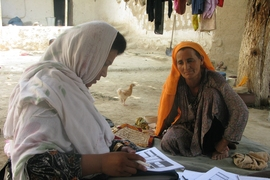 A woman in rural Afghanistan answers questions about the effects of the country's National Solidarity Program.
