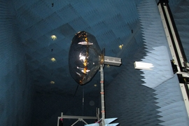 View of a CubeSat equipped with an inflated antenna, in a NASA radiation chamber.