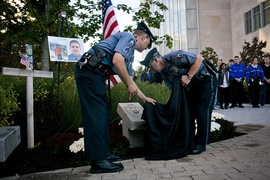 MIT Police officers unveil the new memorial to Officer Sean Collier.