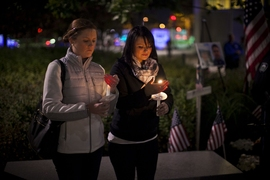 Officer Sean Collier's sisters held the candles from which all others were lit.