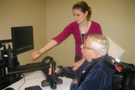After suffering a stroke, a patient learns to operate the robot MIT-Manus to improve mobility.