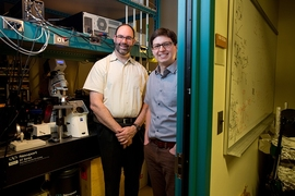 Professor Michael Strano (left) and postdoc fellow Juan Pablo Giraldo in their lab.