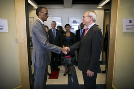 Rwandan president Paul Kagame (left) is greeted by MIT President L. Rafael Reif.