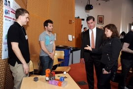 "CSAIL Director Daniela Rus (right) discusses her team's ""M Blocks"" with Boston Mayor Marty Walsh and researchers John Romanishin and Tom Bertossi."