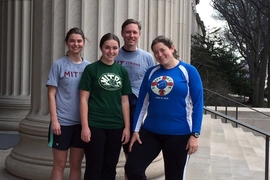 Members of MIT Strong stop on the steps of MIT's 77 Massachusetts Ave. entrance during a training run on March 29. From left: sophomore Sally Miller, Madeline Hickman '11, Tom Gearty, and Rachel DeLucas '03. Miller, Hickman, and DeLucas are members of the MIT Outing Club; Gearty serves as editorial director in MIT Resource Development.