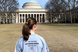 Sophomore Sally Miller of MIT Strong stops in front of MIT's Great Dome at the start of a training run on March 29. The team is made up of students, faculty, staff, and alumni. Miller is one of the volunteer co-organizers of the team.