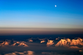 An aerial view of clouds over a mountain range in Greenland.