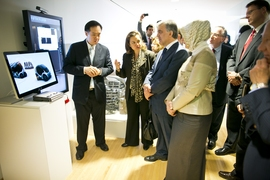 Turkish president Abdullah Gul (center) listens to a presentation on electric vehicles in the MIT Media Lab.